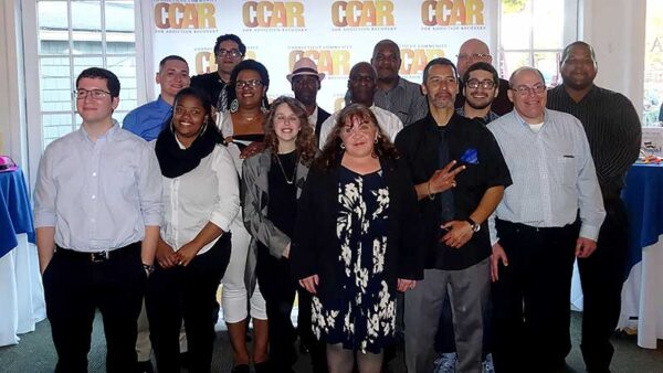 CCAR Volunteers Gathering For a Group Picture at an Event
